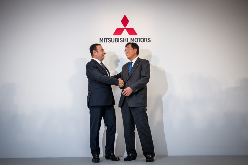 Nissan Motor Co., Ltd., (Nissan) today completed its acquisition of a 34 percent equity stake in Mitsubishi Motors (MMC) and became its largest shareholder. MMC will also become part of the global Alliance with Nissan and Renault. With the addition of MMC, the Alliance will be in the world's top three automotive groups by global volumes, with sales of 10 million units in fiscal year 2016. Pictured is Nissan Chairman and Chief Executive Officer Carlos Ghosn and Osamu Masuko, president and chief executive officer of MMC.