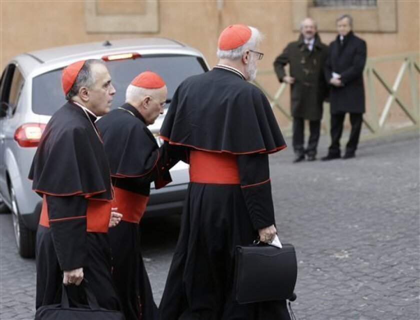 Cardinal Daniel Nicholas DiNardo, left, and Cardinal Sean Patrick O'Malley, right, arrive for a meeting, at the Vatican, Wednesday, March 6, 2013. Cardinals from around the world have gathered inside the Vatican for a round of meetings before the conclave to elect the next pope, amid scandals insid