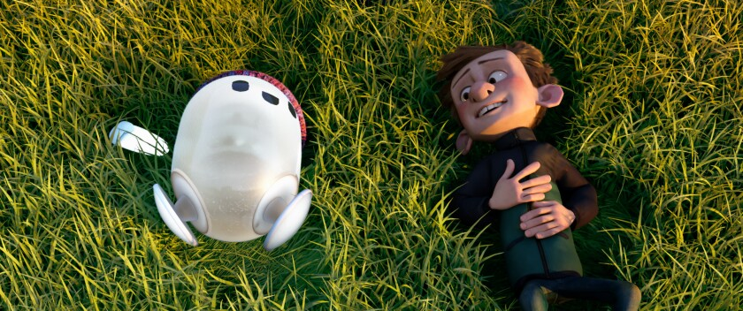 """A boy and his ambulatory digital device lie on grass in the animated movie """"Ron's Gone Wrong."""""""