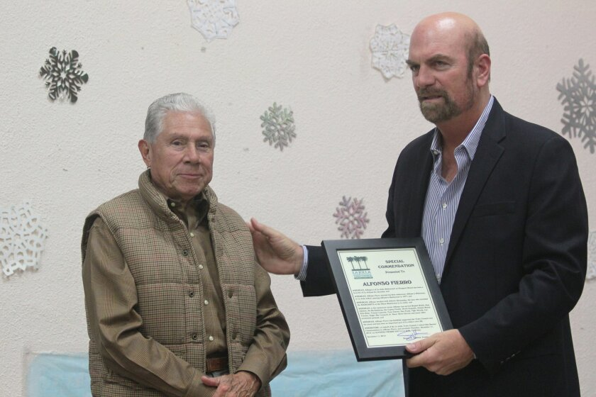La Jolla Town Council President Steve Haskins (right) presents a commendation to La Jolla restaurateur Alfonso Fierro, who is closing his Mexican restaurant on Prospect Street after more than 25 years, when his lease expires next fall. He will open a new location in or near San Diego's North Park n