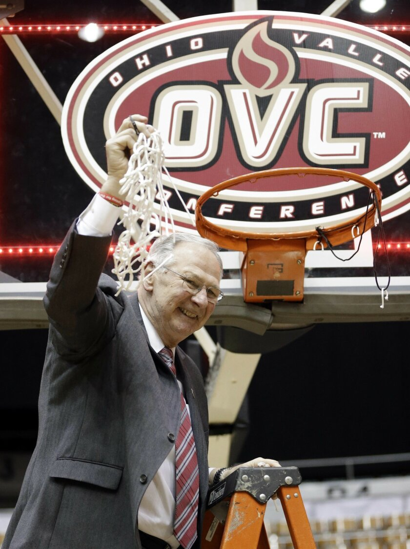 FILE - In this March 5, 2016, file photo, Austin Peay head coach Dave Loos cuts down the net afterdefeating UT Martin in an NCAA college basketball game at the championship of the Ohio Valley Conference basketball tournament in Nashville, Tenn.  Loos coached his Austin Peay Governors to four wins i