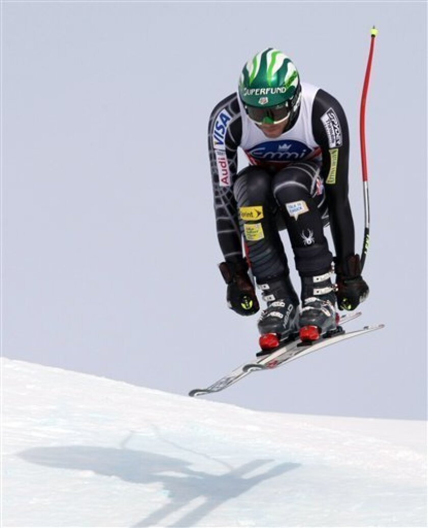 FILE - In this Jan 16, 2010, file photo, Bode Miller, of the United States, is airborne during the men's World Cup downhill  skiing competition at Wengen, Switzerland. U.S. Ski Team men's coach Sasha Rearick says Bode Miller plans to race all five Alpine events at the Vancouver Olympics. (AP Photo/