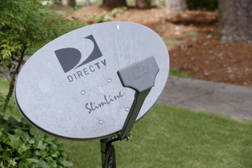 Satellite TV and telephone companies continue to pick up former cable customers, according to a new report by PriceWaterhouseCoopers. Above, a DirecTV satellite receiver dish outside a home in Avondale Estates, Ga.