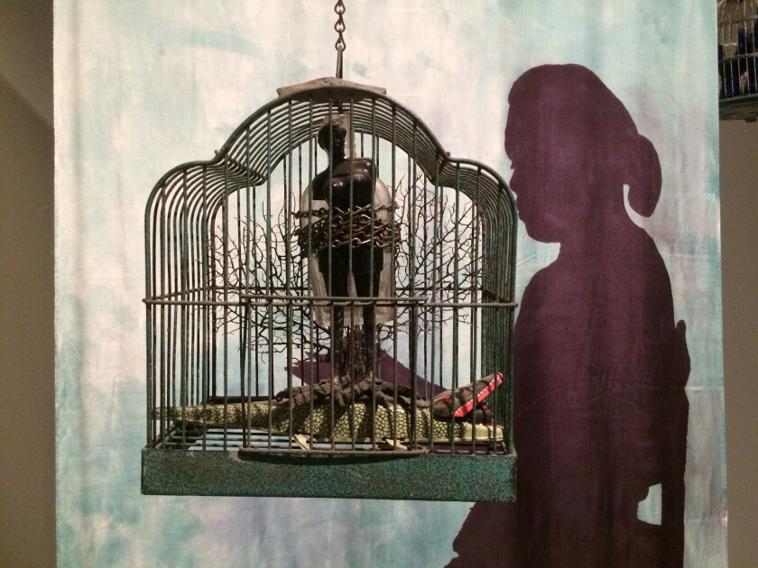 """The Edge of Ethics,""  foreground, and ""Seated Shadow With Bird Cages"" are part of retrospectiv"