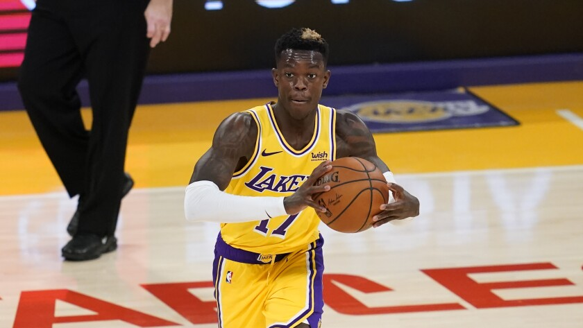 Los Angeles Lakers guard Dennis Schroder (17) passes the ball during the second quarter.