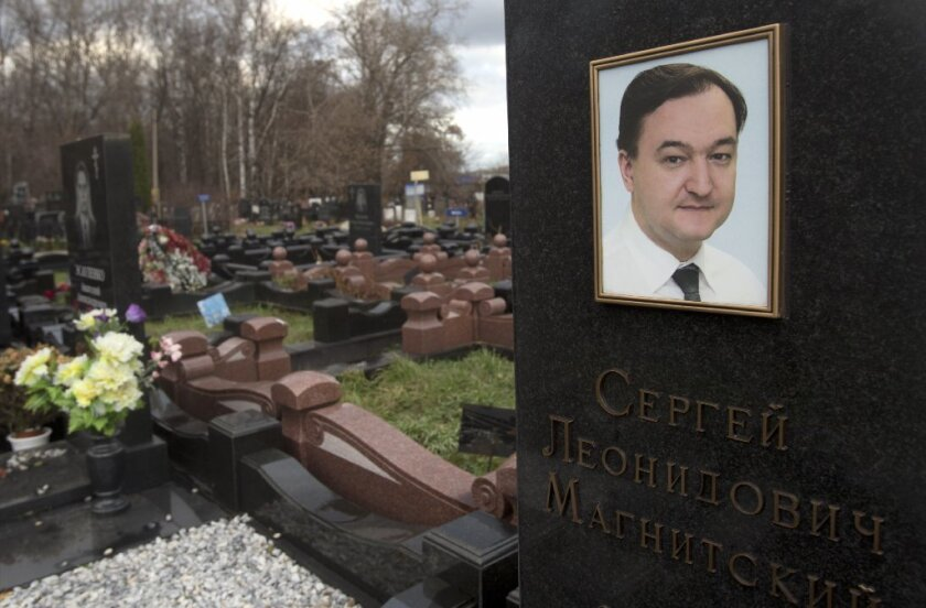 A tombstone on the grave of lawyer Sergei Magnitsky who died in jail, at a cemetery in Moscow, Friday, Nov. 16, 2012. The Magnitsky Act of 2012, a human rights legislation named after Magnitsky, imposes sanctions on Russian officials involved in human rights violations.