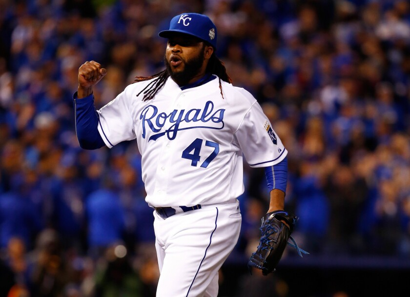 Johnny Cueto celebrates after the end of the eighth inning while pitching for the Royals during the 2015 World Series. Cueto signed with the Giants on Monday.