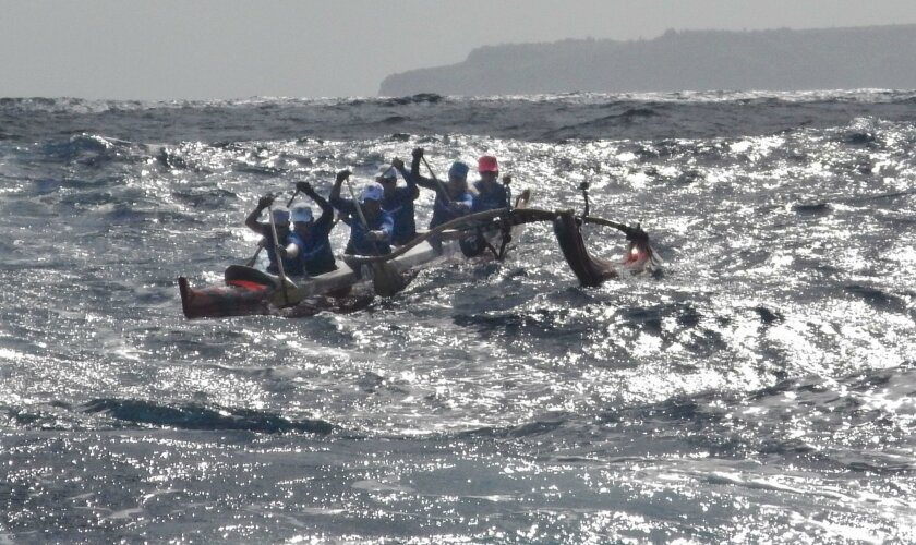 The SoCal Wahines catch a wave in the Pailolo Channel about six miles into the race. Outrigger canoe teams competed last month in the ninth annual Pailolo Challenge, a 28-mile race from Maui to Molokai that's sponsored by the Hawaiian Canoe Club.