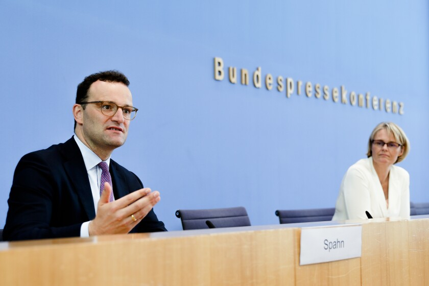 German Health Minister Jens Spahn, left, and Science and Education Minister Anja Karliczek, right, brief the media during a news conference about a german program to support the develop a COVID-19 vaccine in Berlin, Germany, Tuesday, Sept. 15, 2020.(AP Photo/Markus Schreiber, Pool)