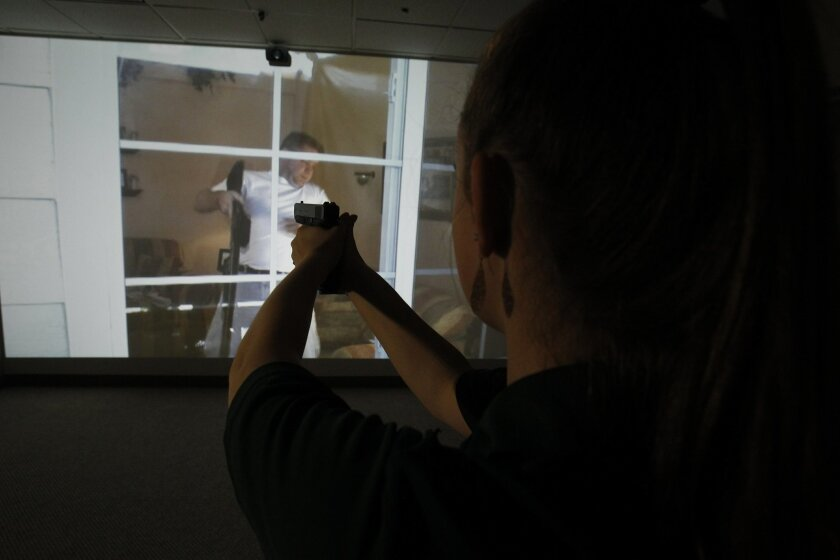 The first law enforcement style shooting simulator is now open and available to civilians at Empowered Firearms, a new firearm training and gun store in Vista. LeAnne Farmer is the owner of the facility, and with her daughter Christa, shown here, they showed some of the simulators' different evolut