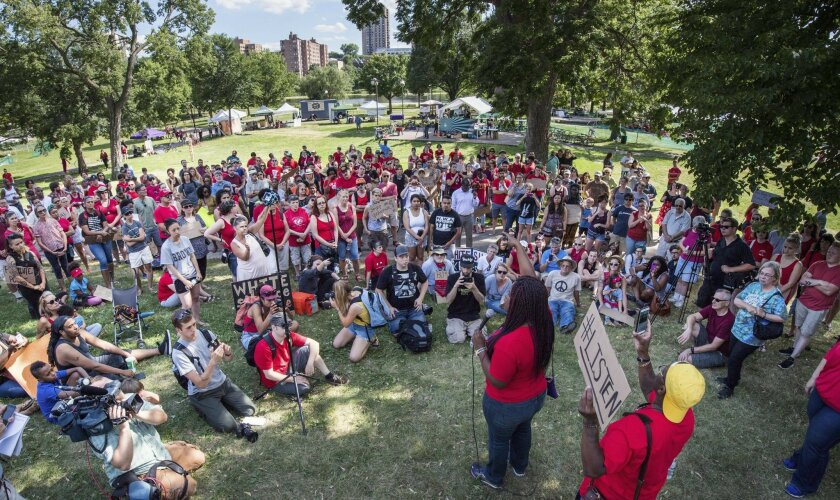 FILE - In this July 9, 2016 file photo, Nekima Levy-Pounds, head of the Minneapolis NAACP, speaks at a Black Lives Matter rally in Minneapolis. The killing of Philando Castile by a Minnesota police officer during a traffic stop last week tore open wounds that hadn't yet healed in Minnesota's black community from a previous officer-involved death last year. Levy-Pounds says she doesn't have faith in the justice system anymore. (Glen Stubbe/Star Tribune via AP, File)