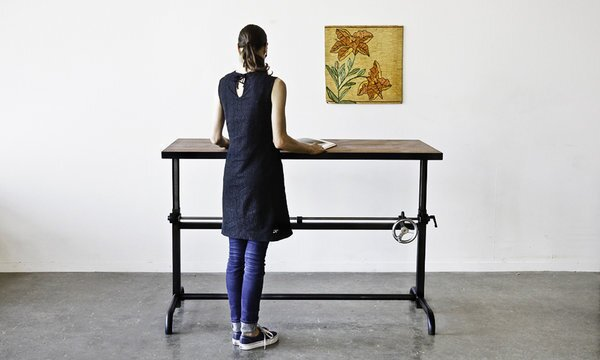 """For a handcrafted take on the idea: The Adler table from Ohio Design in San Francisco has a crank made from steel gears and a chromed, cast-iron handle. The work surface shifts from 27 to 42 inches high and can be ordered in a variety of woods, including walnut, oak and maple. Power-coated steel legs are available in """"practically any color."""" It's $1,925. www.ohiodesign.com"""