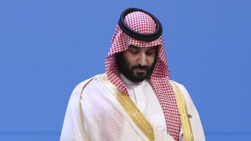 Saudi Arabia's Crown Prince Mohammed bin Salman stands as leaders gather for the family photo of the