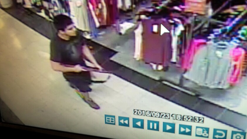 Authorities say a surveillance video shows an armed Arcan Cetin at the Cascade Mall in Burlington, Wash..
