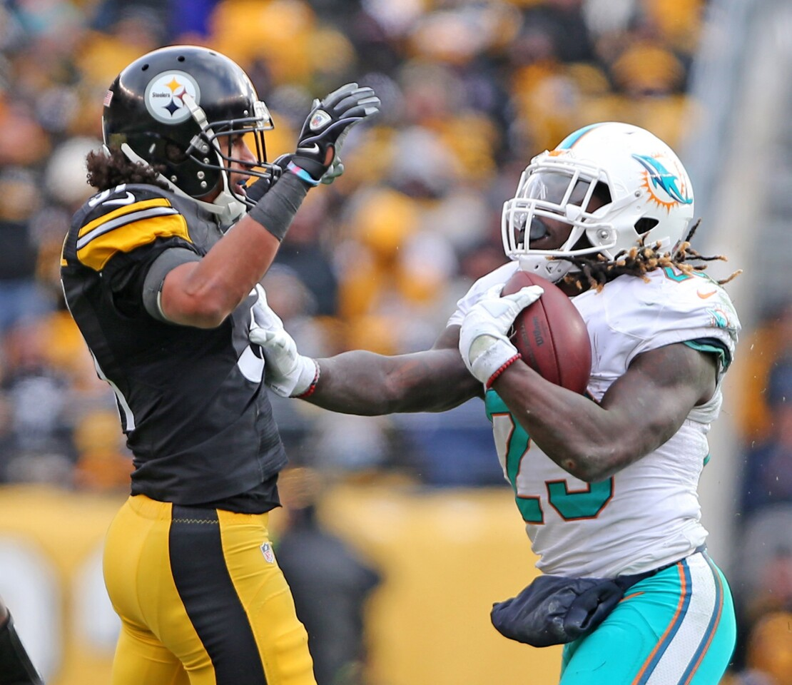 Miami Dolphins' Jay Ajayi gets upset with Pittsburgh Steelers' Ross Cockrell after a tackle in the second quarter during the NFL Wild Card Playoffs on Sunday, Jan. 8, 2017 at Heinz Stadium in Pittsburgh, Pa. (Charles Trainor Jr./Miami Herald/TNS) ** OUTS - ELSENT, FPG, TCN - OUTS **