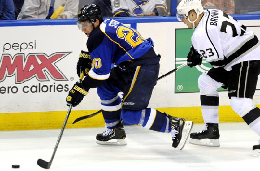 Kings right wing Dustin Brown tries to chase down Blues left wing Alexander Steen during the third period of Game 1 on Tuesday night in St. Louis.