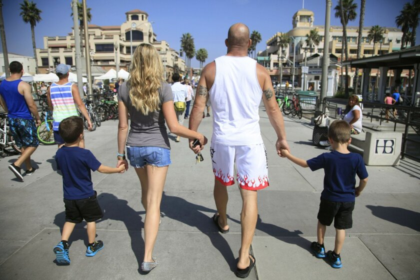 October 11th, 2014 Huntington Beach, CA- Tito Ortiz and his girlfriend Amber Nichole Miller take a walk on the Huntington Beach pier with his sons Jesse,right, and Journey, left. Photo by David Brooks/ U-T San Diego MANDATORY PHOTO CREDIT DAVID BROOKS / U-T SAN DIEGO; ZUMA Press.
