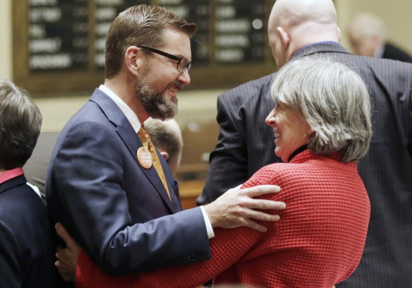 Last week, gay marriage sponsors Rep. Karen Clark, right, and Sen. Scott Dibble celebrate after the Minnesota House passed the gay marriage bill. The two openly gay Minnesota state lawmakers, who respectively sponsored the measure in the state House and Senate, prepared to watch Democratic Gov. Mark Dayton sign the bill in a ceremony Tuesday.