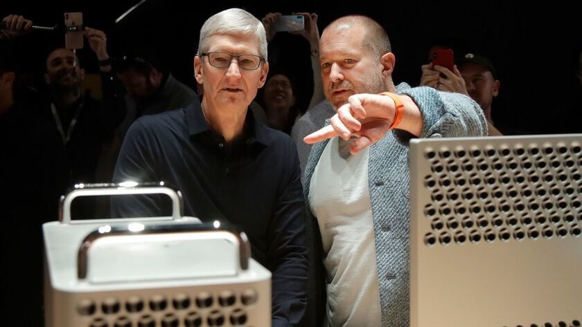 Apple's chief design officer, Jony Ive, right, and Chief Executive Tim Cook at the 2019 Apple Worldwide Developer Conference on June 3.