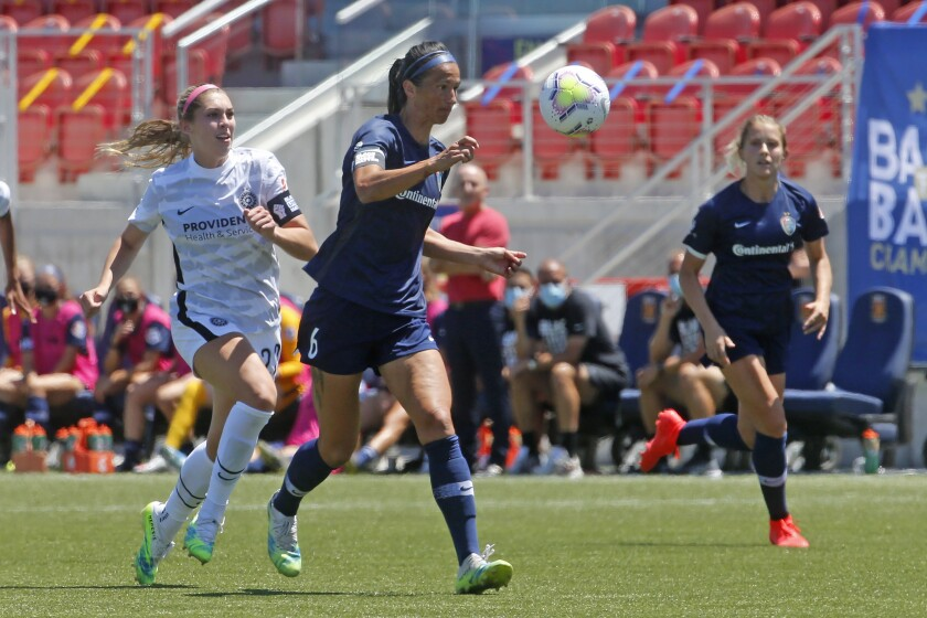 North Carolina Courage defender Abby Erceg (6) controls the ball as Portland Thorns forward Morgan Weaver, left, defends during the second half of an NWSL Challenge Cup soccer match at Zions Bank Stadium Saturday, June 27, 2020, in Herriman, Utah. Coach Paul Riley calls defender Abby Erceg the bedrock of the North Carolina Courage. The New Zealand native is captain of the Courage, the two-time National Women's Soccer League defending champions. (AP Photo/Rick Bowmer)