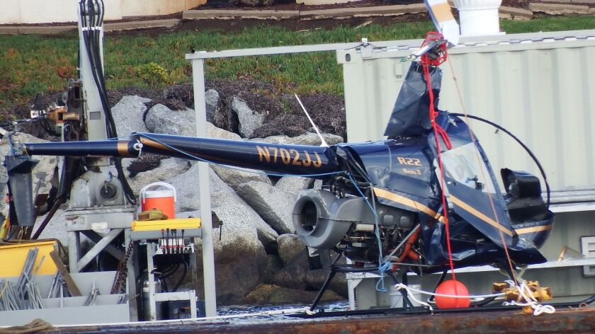The helicopter recovered from the crash site near the Angels Gate Lighthouse at the end of the breakwater.