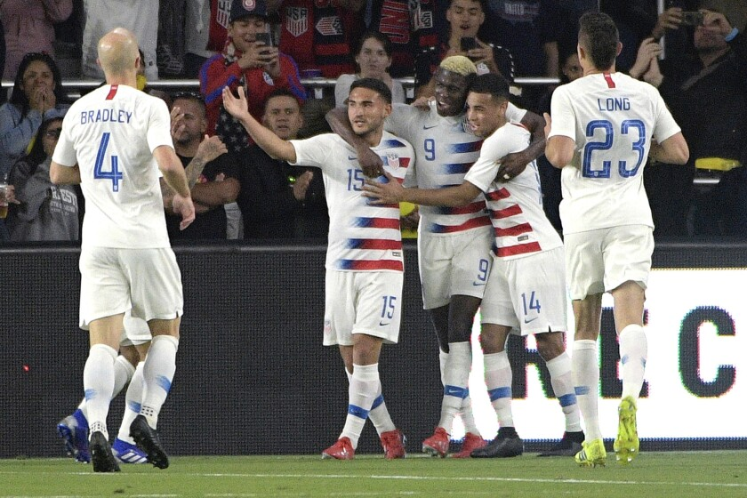 United States forward Gyasi Zardes (9) is congratulated by teammates after scoring a goal during the