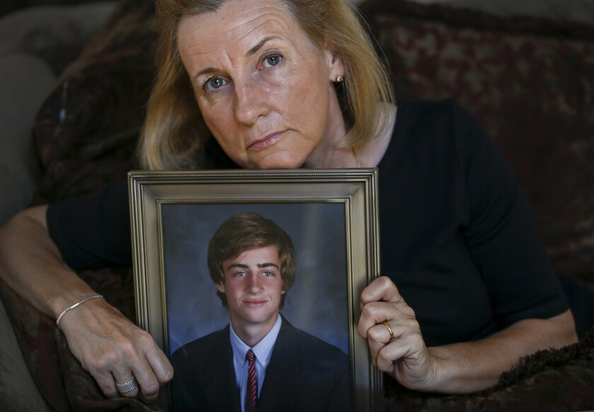 Aimee Dunkle of Rancho Santa Margarita holds a portrait of her son Ben, who died from a drug overdose four years ago. Dunkle has distributed hundreds of doses of naloxone, a drug that she believes would have saved her son.