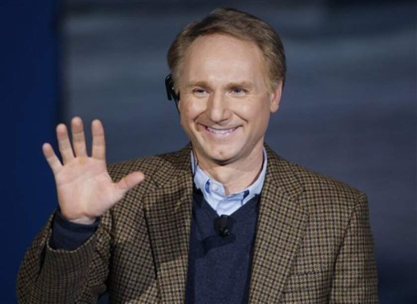 "FILE - In this Dec. 6, 2009 file photo, writer Dan Brown, author of ""The Da Vinci Code,"" waves as he appears on the Italian State RAI TV program ""Che Tempo che Fa"", in Milan, Italy. Brown on Friday, May 18, 2012 made a rare public appearance in Portsmouth, N.H., sharing stories about writing, movie"