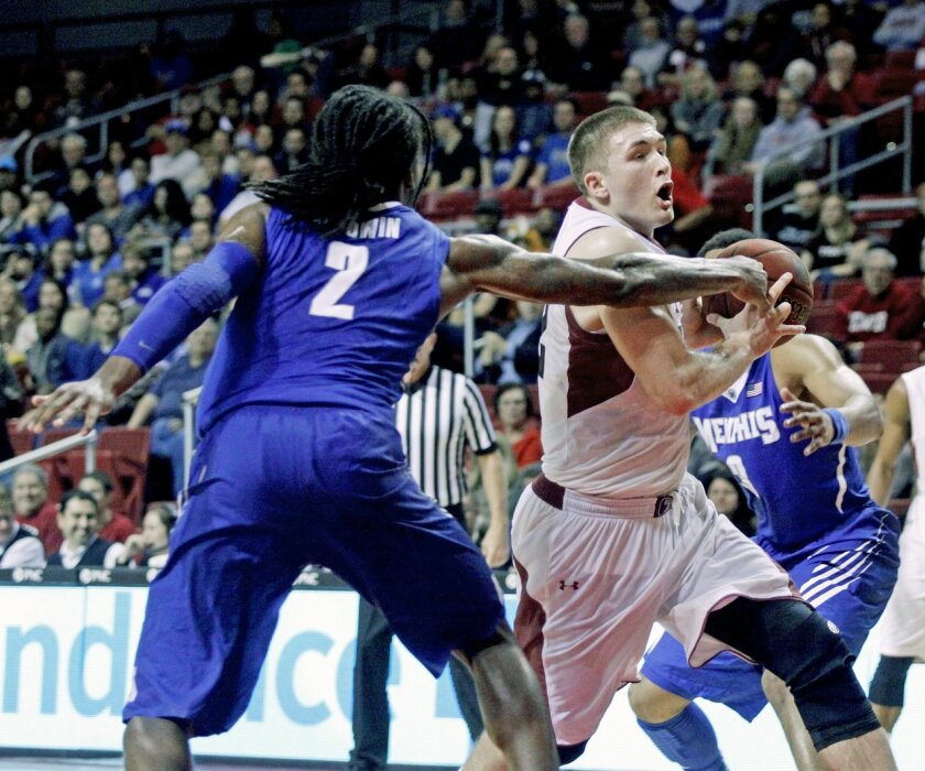 Temple's Dalton Pepper, right drives against Memphis' Shaq Goodwin (2) in the second half of an NCAA college basketball game, Saturday, Jan. 11, 2014, in Philadelphia. Memphis won 79-69. (AP Photo/H. Rumph Jr.)