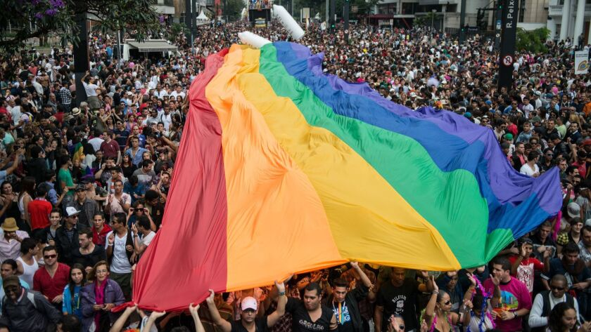 A huge rainbow flag is unfold during the