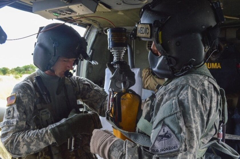 Campbell demonstrates how to set up and prepare for hoist training before lift off. Photo courtesy U.S. Army