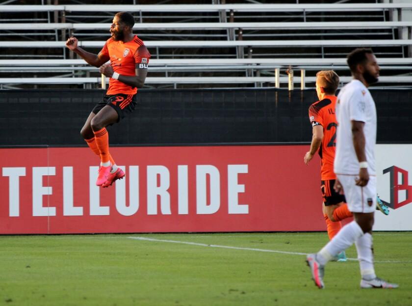 "Orange County Soccer ClubSean ""Ugo"" Okoli celebrates scoring a goal."