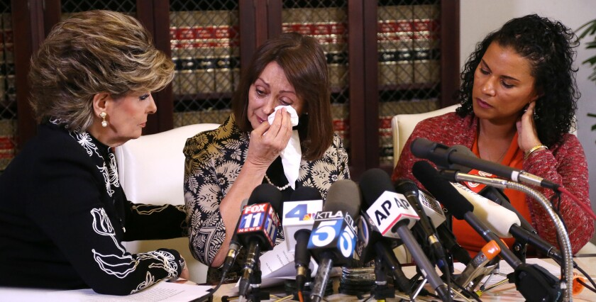 Linda Brown, center, and Lise-Lotte Lublin, right, during a news conference with attorney Gloria Allred, left, on Thursday. The two former models are the latest women to accuse entertainer Bill Cosby of sexual assault.