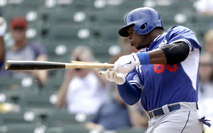 Dodgers outfielder Yasiel Puig connects for a broken-bat single in the first inning against the Arizona Diamondbacks on Wednesday in Scottsdale, Ariz.