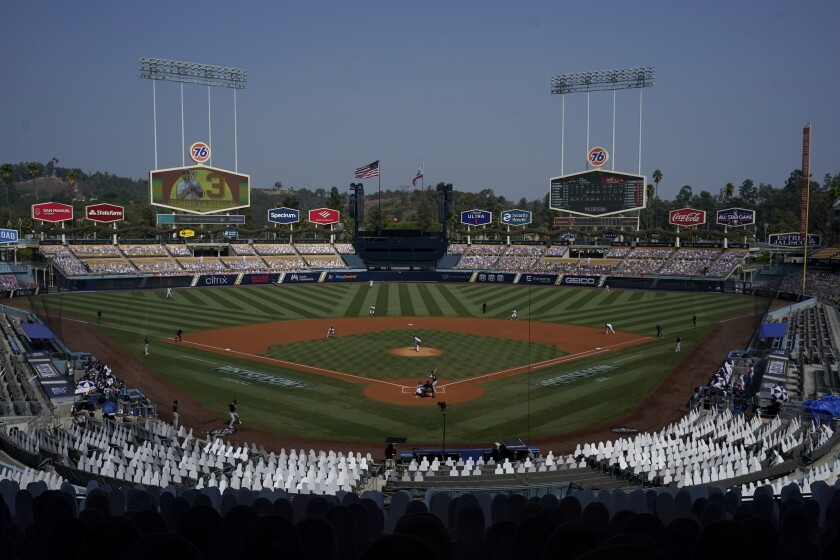 Cutouts are seated at Dodger Stadium as Houston Astros' Zack Greinke, center, pitches against the Oakland Athletics during the first inning of Game 4 of a baseball American League Division Series in Los Angeles, Thursday, Oct. 8, 2020. (AP Photo/Marcio Jose Sanchez)