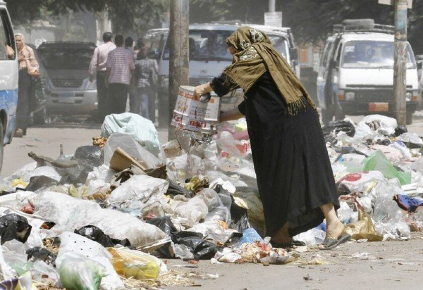 In Egypt, post-revolution chaos stinks, with trash piling up