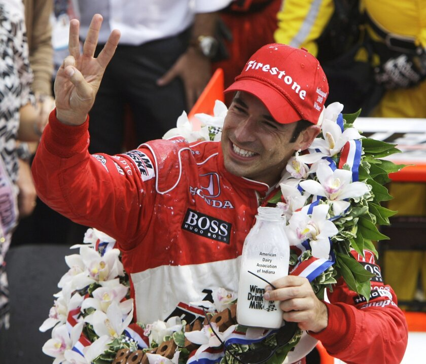 FILE - In this May 24, 2009 file photo, Helio Castroneves, of Brazil, holds up three fingers after winning his third Indianapolis 500 auto race, at Indianapolis Motor Speedway in Indianapolis, Ind. Trying to convince Helio Castroneves to rank his three Indianapolis 500 victories is tantamount to asking an adoring mother or father to rank their children in order of affection. (AP Photo/Darron Cummings, File)