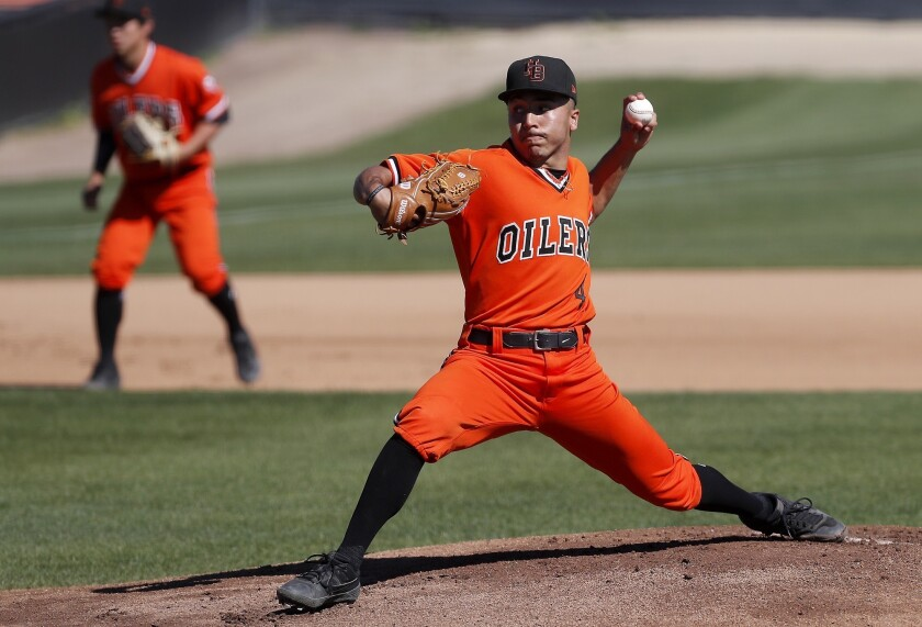 Huntington Beach High starter Eddie Pelc throws against Fountain Valley during the first inning in a