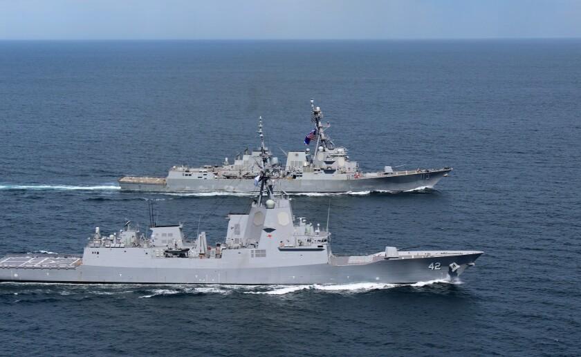 The HMAS Sydney, foreground, and USS John Finn, back