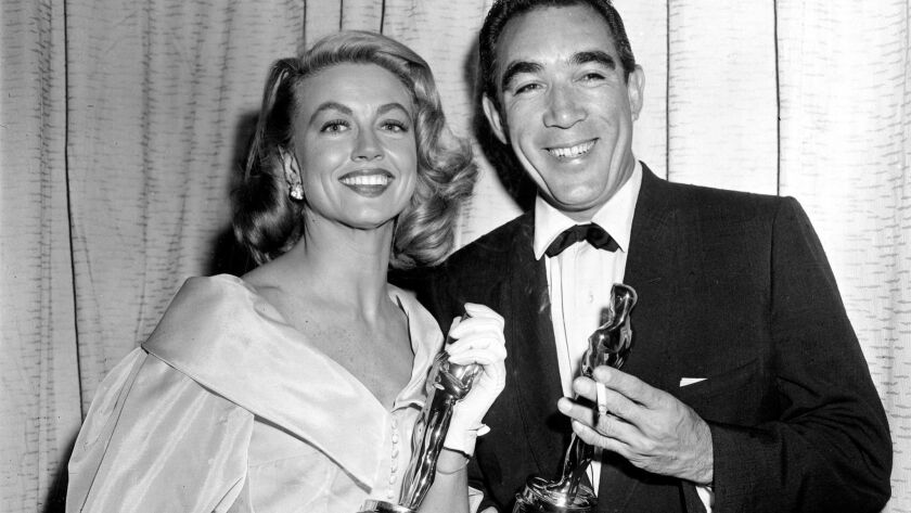 Oscar winners Dorothy Malone and Anthony Quinn at the Academy Awards in March 1957.