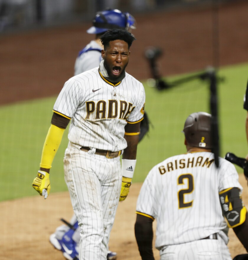 Jurickson Profar celebrates after scoring in the seventh inning Monday night.