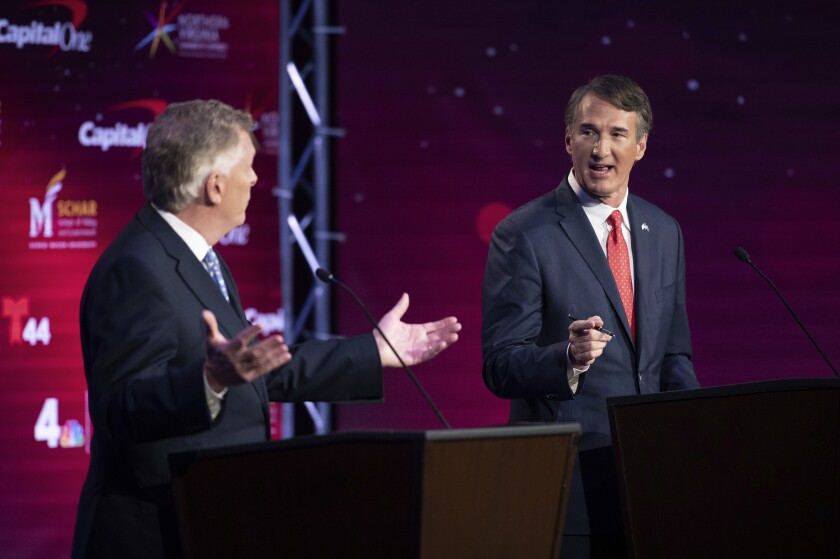 Virginia Democratic gubernatorial candidate and former Gov. Terry McAuliffe, left, and Republican challenger, Glenn Youngkin, participate in their debate at Northern Virginia Community College, in Alexandria, Va., Tuesday, Sept. 28, 2021. (AP Photo/Cliff Owen)