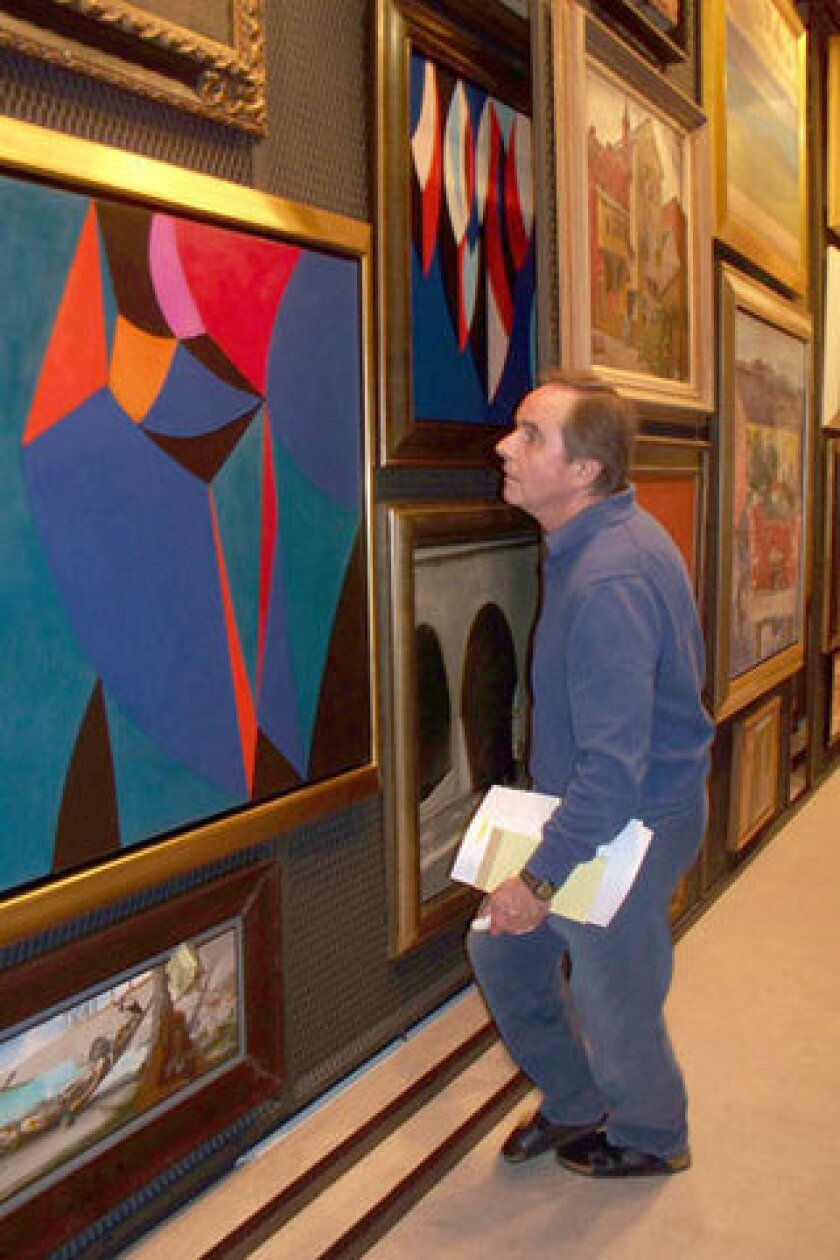 Gerald Buck, an Orange County businessman who had a vast personal collection of 20th century art that he sometimes loaned to area museums, has died. He was 73. Photo of Gerald Buck at his private, invitation-only art display space in Laguna Beach, looking at some of the artworks in storage there.