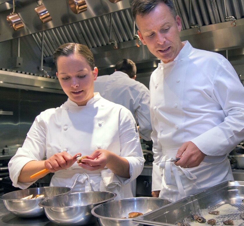 Chef William Bradley, middle, works with some of his assistants in the afternoon at the Addison at the Fairmont Del Mar Resort as they prepare for dinner. At left is Stefani De Palma and at right is Daniel Romero.
