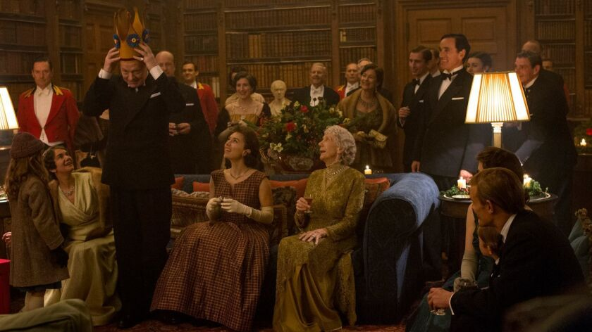 "The royal family (Victoria Hamilton, Jared Harris, Vanessa Kirby and Eileen Atkins, from left) celebrate Christmas in ""The Crown."""