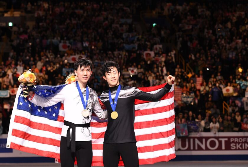 Gold medalist free skater Nathan Chen, right, and bronze winner Vincent Zhou in 2019.