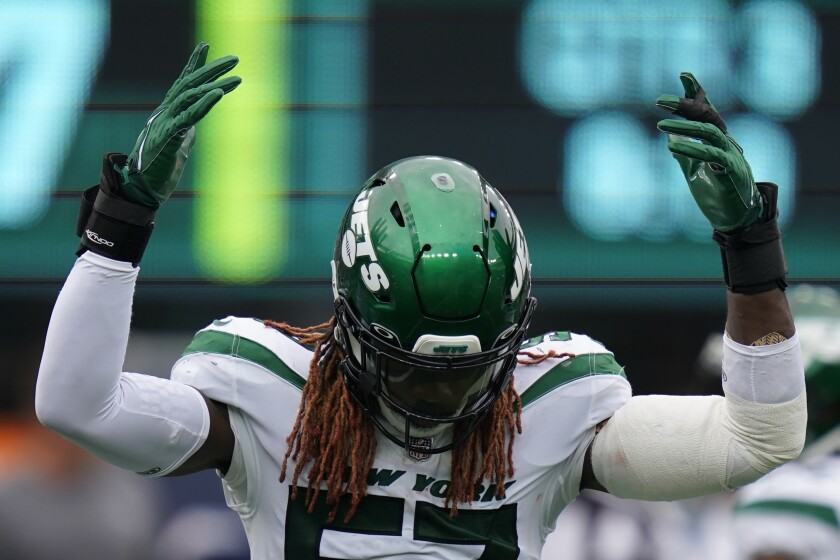New York Jets middle linebacker C.J. Mosley reacts after making a tackle during the second half of an NFL football game against the Tennessee Titans, Sunday, Oct. 3, 2021, in East Rutherford, N.J. (AP Photo/Seth Wenig)