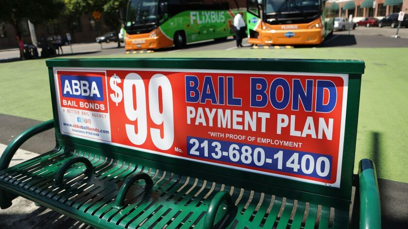A sign advertises a bail bond company on Aug. 29 in L.A. California has ended its money bail system.