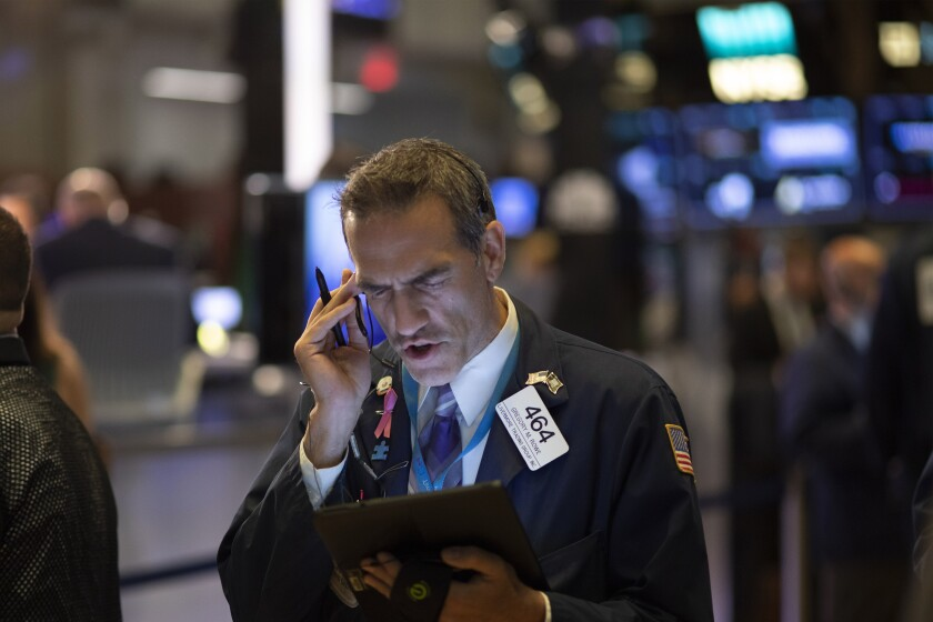 FILE - In this Sept. 18, 2019, file photo Stock trader Gregory Rowe works at the New York Stock Exchange. The U.S. stock market opens at 9:30 a.m. EDT on Friday, Sept. 27. (AP Photo/Mark Lennihan, File)