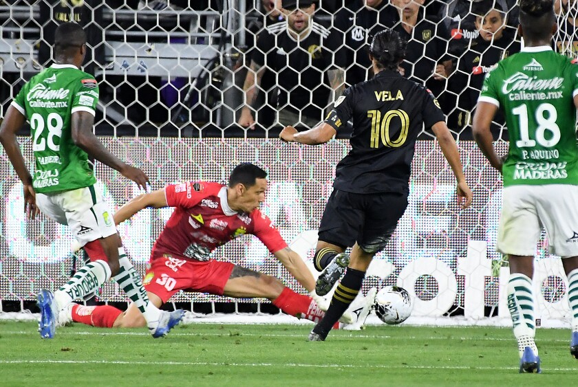 LAFC's Carlos Vela scores a goal against  León in the second half of a CONCACAF Champions League match.